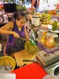 Bangkok,Thailand, on May 26, 2018, Ladprao fresh food market, pe. Bangkok,Thailand, on May 26, 2018, Ladprao fresh food market, women peeling Durian, King of stock photo