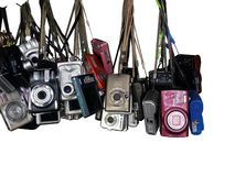 Bangkok, Thailand - May 15, 2018 Old used digital compact cameras of hanging isolated on white stock images