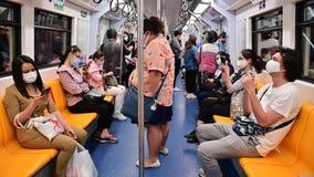 Bangkok, Thailand - May 12, 2020 : Passenger inside subway train on rush hour wear mask protect from covid-19 virus
