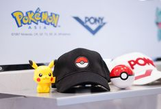 A black cap with Pokeball by Pony International, American footwear and clothing. royalty free stock photo