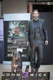 A photo of John Wick and his Pitbull dog, partner in crime. Life size figure of John Wick is royalty free stock image