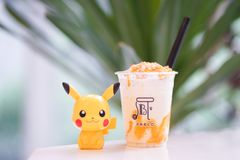 Pablo smoothie classic cheese tart with Pikachu, a famous character from Pokemon royalty free stock images