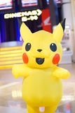 Pikachu mascot is walking around in front of the cinema to promote the movie Pokemon royalty free stock photo