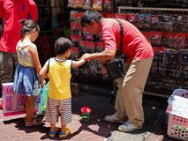 Toy street vendor with children Royalty Free Stock Photography