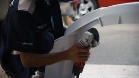 Checking car fiber bumper body part at car garage. Bangkok, Thailand - May 7, 2017 : Unidentified car mechanic or serviceman check and fix fiber bumper body part stock video footage