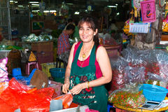 Woman selling fresh flowers at the morning market in Bangkok Royalty Free Stock Photography