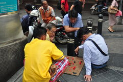 Bangkok, Thailand: Men Playing Chess Royalty Free Stock Image