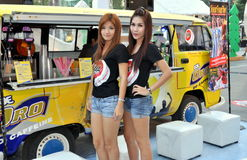 Bangkok, Thailand: Models at Central World. Two lovely young women models at a coffee company promotional event held in the Central World s hopping mall plaza on Stock Photos