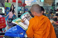 Bangkok, Thailand: Monk Reading Magazine Stock Images