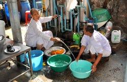 Bangkok, Thailand: Monks Doing Laundry Royalty Free Stock Image