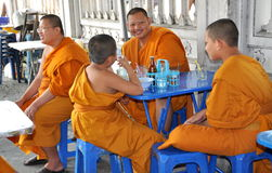 Bangkok, Thailand: Monks Eating Lunch Stock Photo