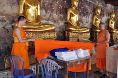 Bangkok, Thailand: Monks Folding Robe Stock Photography