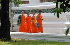 Bangkok, Thailand: Monks at Suthat Temple Royalty Free Stock Photos