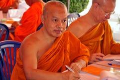 Bangkok, Thailand: Monks at Suthat Temple Royalty Free Stock Photography