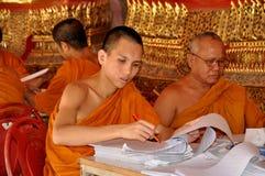 Bangkok, Thailand: Monks at Wat Suthat Royalty Free Stock Image