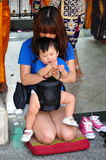 Bangkok, Thailand: Mother & Son Praying at Shrine Royalty Free Stock Photo