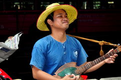 Bangkok, Thailand: Musician on Silom Road Royalty Free Stock Images