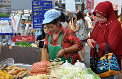 Bangkok, Thailand: Muslim Woman Buying Street Food Stock Photo