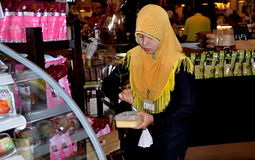 Bangkok, Thailand; Muslim Woman Clerk at Super Market Royalty Free Stock Photos