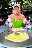 Bangkok,Thailand:Muslim women cooking Roti dessert Royalty Free Stock Photos