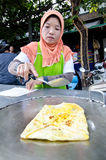 Bangkok,Thailand:Muslim women cooking Roti dessert Royalty Free Stock Images
