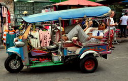 Bangkok, Thailand: Napping Tuk-Tuk Taxi Driver Royalty Free Stock Photos