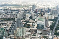 Bangkok, Thailand - Nov 20, 2018: Cityscape aerial top view of tall buildings, homes, road traffic, and under construction site stock photo