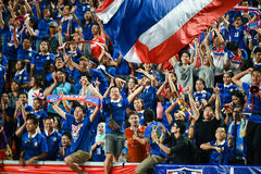 BANGKOK THAILAND NOV12: 2015 Unidentified fans of Thailand support. Ers celebrate during the Fifa World Cup Group F qualifying Match between Thailand and Chinese Stock Image