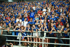 BANGKOK THAILAND NOV12: 2015 Unidentified fans of Thailand support. Ers celebrate during the Fifa World Cup Group F qualifying Match between Thailand and Chinese Royalty Free Stock Photo