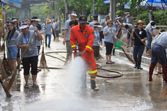 BANGKOK THAILAND - NOV21 : Unidentified people go to Phaholyothin Rd.and washing cleaning the road after end of flood in this are royalty free stock photo
