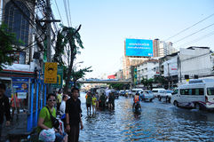 BANGKOK, THAILAND - NOVEMBER 04. Heavy flooding from monsoon rain in Ayutthaya and north Thailand arriving in Bangkok on November 04,2011 Bangkok, Thailand.At Stock Photos