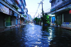 BANGKOK, THAILAND - NOVEMBER 04. Heavy flooding from monsoon rain in Ayutthaya and north Thailand arriving in Bangkok on November 04,2011 Bangkok, Thailand.At Royalty Free Stock Photos