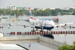 Bangkok, Thailand - November 9, 2011 : Airplanes drown in the water at Don Muang International Airport during the massive flood cr Royalty Free Stock Photos