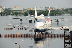 Bangkok, Thailand - November 9, 2011 : Airplanes drown in the water at Don Muang International Airport during the massive flood Stock Images