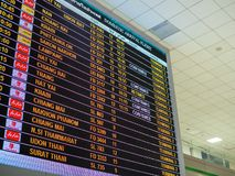 Boarding time monitor screens in airport royalty free stock photo