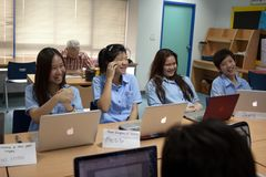 A group of students in a classroom working together on an exercise Stock Image