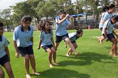 In a college in Bangkok, school children during an outdoor sport. BANGKOK, THAILAND - NOVEMBER 22, 2012: In a college in Bangkok, school children during an stock photos