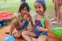 In a college in Bangkok, after a swimming course, school childre. BANGKOK, THAILAND - NOVEMBER 22, 2012: In a college in Bangkok, after a swimming course, school Royalty Free Stock Photos