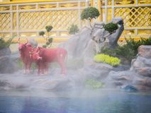 Mythical creatures of Himvanta. Bangkok Thailand, November 11, 2017 : Cow-like mythical creatures of Himvanta around The Royal crematorium of King Rama IV Stock Photography