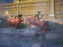 Mythical creatures of Himvanta. Bangkok Thailand, November 11, 2017 : Cow-like mythical creatures of Himvanta around The Royal crematorium of King Rama IV Royalty Free Stock Photo
