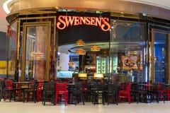 Exterior view of a Swensen`s Restaurant at the Siam Paragon Mall. Bangkok, Thailand. BANGKOK, THAILAND - NOVEMBER 19, 2013 : Exterior view of a Swensen`s Stock Photography