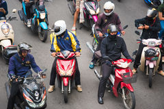 BANGKOK, THAILAND - NOVEMBER 28, 2016 : Motorcyclists wait for a green light at intersection with crosswalk on the city road. stock image