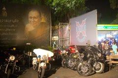 Bangkok, Thailand - November 22, 2014: Motorycles lined up near. Several motorcycles at a local biker gathering in Bangkok are lined up beneath a billboard Stock Images