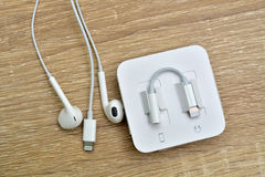 Bangkok, Thailand - November 23, 2016 : New Apple iPhone 7 unbox. Ing in the first day of sales. - Lightning to 3.5 mm Headphone Jack Adapter and Earpods. New Stock Photos
