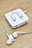 Bangkok, Thailand - November 23, 2016 : New Apple iPhone 7 unbox. Ing in the first day of sales. - Lightning to 3.5 mm Headphone Jack Adapter. New Apple iPhone Royalty Free Stock Photo
