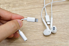 Bangkok, Thailand - November 23, 2016 : New Apple iPhone 7 unbox. Ing in the first day of sales. - Lightning to 3.5 mm Headphone Jack Adapter. New Apple iPhone Royalty Free Stock Images