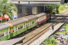 Old train and passengers at Ladkrabang railway station,. Bangkok, Thailand - November 8, 2017: Old train and passengers at Ladkrabang railway station stock images