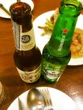 Bangkok,Thailand November 18,2018 party at restaurant Group of happy friends eating and drinking beers .Focus Bottle beers.. royalty free stock photography