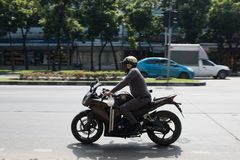 Bangkok, Thailand - November 16, 2016: Police is racing motorcycle on the road and go to work . black motorbike and yellow helmet stock photo