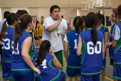 A coach gives advice to the basketball players. Royalty Free Stock Image